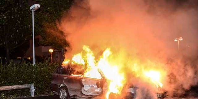 May 21, 2013: A burnt out car,  in the Stockholm suburb of Kista after youths rioted in several different suburbs around Stockholm for a third executive night. Immigrant youth in sleepy suburban communities run amok, hurling rocks at police and torching cars, restaurants and culture centers.