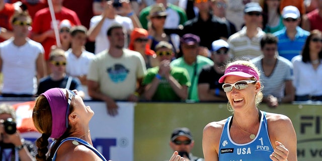 July 7, 2012: USA';s Misty May-Treanor, left, and Kerri Walsh celebrate their victory after the final game during the beach volleyball  Worldtour in Gstaad, Switzerland.
