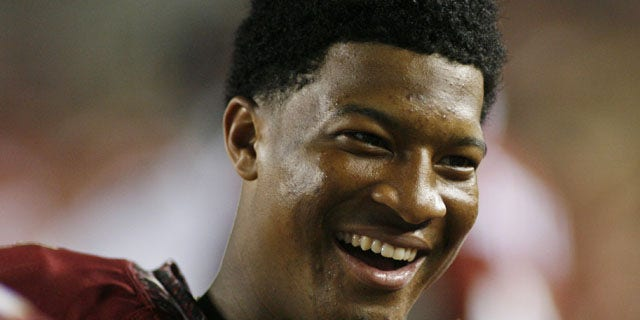 November 16, 2013: Florida State quarterback Jameis Winston (5) smiles on the sidelines in the fourth quarter of an NCAA college football game against Syracuse in Tallahassee, Fla. (AP Photo)