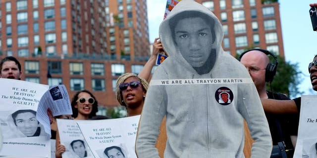 Activists in New York City with a cut out photo of Trayvon Martin, in 2013.