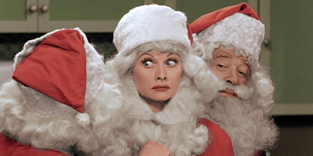 "This image released by CBS shows Lucille Ball, center, dressed as Santa Claus in a colorized ""I Love Lucy Christmas Special."" (AP Photo/CBS)"