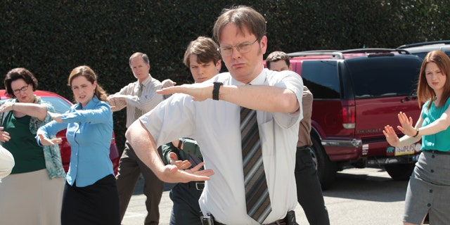 """May 16, 2013: This publicity image released by NBC shows the cast of """"The Office"""" in a scene from the series finale."""
