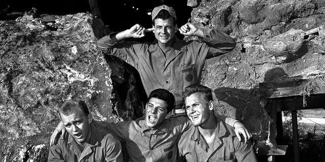 """From l-r: Gary Crosby, Frankie Avalon and Tab Hunter harmonize while Jody McCrea holds his ears against the singing, Jan. 1963. All play members of a naval demolition team in the film """"Bikini."""""""