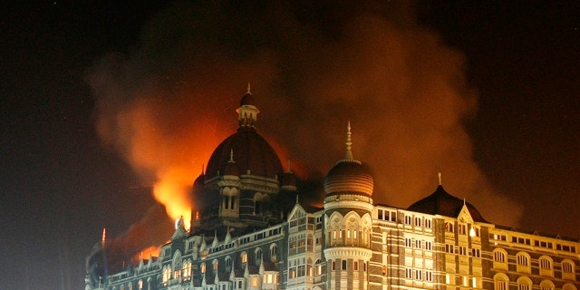 Nov. 27, 2008:  Smoke rises from the Taj Hotel in Mumbai. Gunmen killed at least 80 people in a series of attacks in India's financial capital.