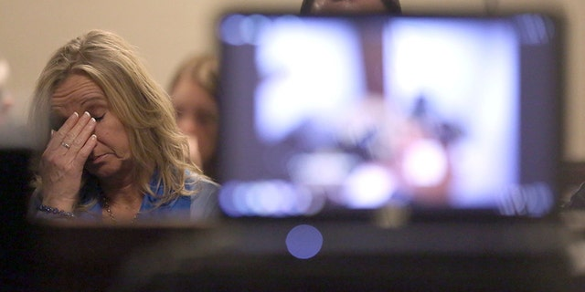 Tammy Weeks, mother of victim Nicole Lovell, reacts as David Eisenhauer's police interview video is played in Montgomery County Circuit Court in Christiansburg Va., Tuesday, Feb. 6, 2018.
