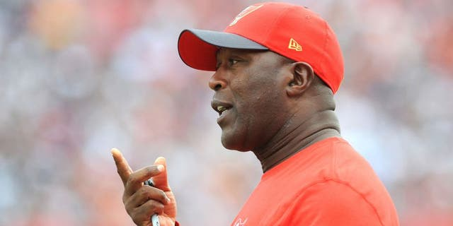 TAMPA, FL - NOVEMBER 15: Head coach Lovie Smith of the Tampa Bay Buccaneers questions an officials call in the second quarter against the Dallas Cowboys at Raymond James Stadium on November 15, 2015 in Tampa, Florida. (Photo by Cliff McBride/Getty Images)