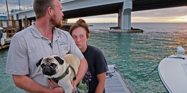 The couple's sailboat sank after they hit a sandbar off the coast of Florida, two days into their adventure to the Caribbean.