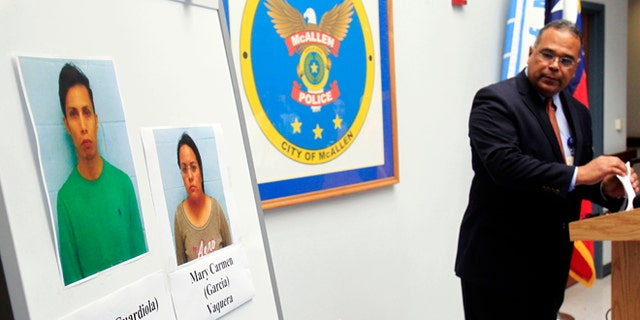 ADDS RECENT DEVELOPMENT- McAllen Police Chief Victor Rodriguez displays photos of Daniel Guardiola Dominiguez, left, and Mary Carmen Garcia, who were arrested Sunday after arriving at the border with 96 fraudulent credit cards that were produced using data stolen during the Target security breach late last year, Monday, Jan. 20, 2014, in McAllen, Texas. Rodriguez said Monday Jan. 20, 2014,  that two Mexican citizens who were arrested at the border used account information stolen during the Target security breach to buy tens of thousands of dollars' worth of merchandise. But a federal official said later there currently was no connection between the arrests and the retailer's credit card data theft. (AP Photo/The Monitor, Gabe Hernandez)  MAGS OUT; TV OUT (AP Photo/The Monitor, Gabe Hernandez)  MAGS OUT; TV OUT
