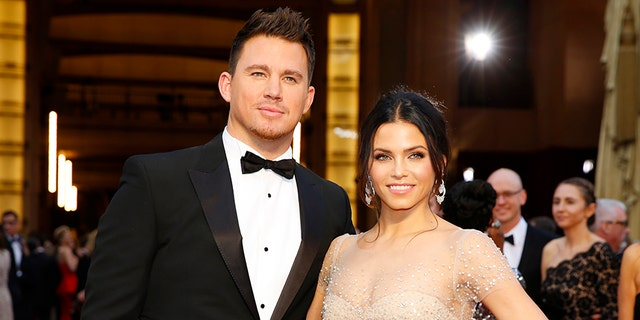 Channing Tatum and Jenna Dewan arrive on the red carpet at the 86th Academy Awards in Hollywood, California March 2, 2014.