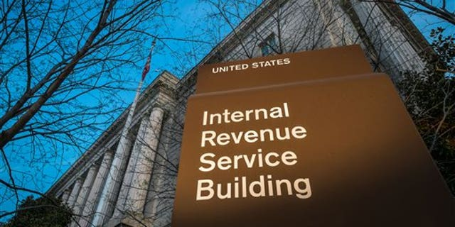This photo taken April 13, 2014 shows the headquarters of the Internal Revenue Service (IRS) in Washington at daybreak. Tuesday, April 15, is the federal tax filing deadline for most Americans. (AP Photo/J. David Ake)