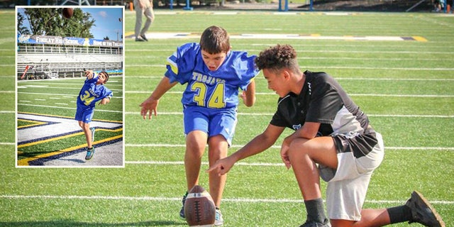 Taylan Orton playing on the Findlay High School football field before the game Friday night.