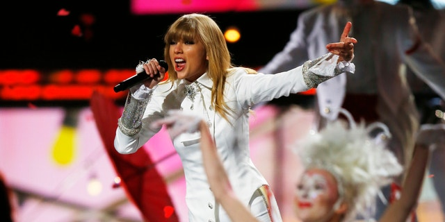Taylor Swift performs at the 55th annual Grammy Awards.