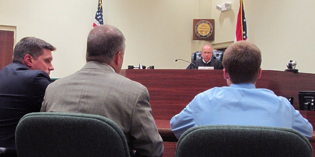 July 31, 2012: In this photo, Warren County Juvenile Court Judge Mike Powell warns 17-year-old Ohio high school student Tyler Pagenstecher, right, of the consequences of admitting guilt at his first hearing in Lebanon, Ohio.