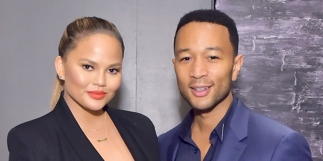Chrissy Teigen appears with husband John Legend.The 'Cravings' author said she is no longer giving into the societal norms of dieting. 'I eat things when I want them,' she said.