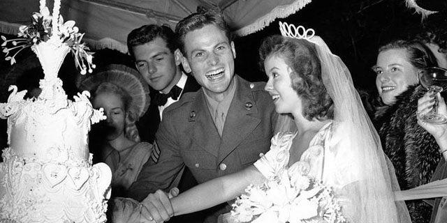 Shirley Temple with John Agar on their wedding day.