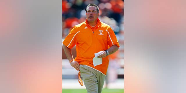 FILE - In this April 12, 2014, file photo, Tennessee head coach Butch Jones walks during the annual Orange and White NCAA college spring football game in Knoxville, Tenn. Jones looks ahead to his second season on the job. (AP Photo/Wade Payne, File)