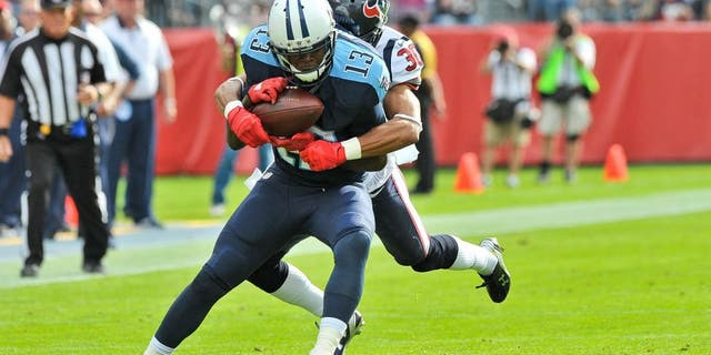 Dec 27, 2015; Nashville, TN, USA; Tennessee Titans wide receiver Kendall Wright (13) is tackled by Houston Texans strong safety Kevin Johnson (30) during the first half at Nissan Stadium. Mandatory Credit: Jim Brown-USA TODAY Sports