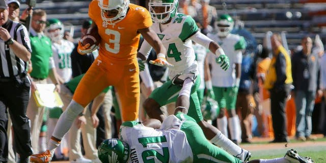 Nov 14, 2015; Knoxville, TN, USA; Tennessee Volunteers wide receiver Josh Malone (3) runs the ball against North Texas Mean Green defensive back James Gray (21) during the first half at Neyland Stadium. Mandatory Credit: Randy Sartin-USA TODAY Sports