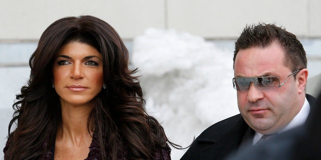 """Teresa Giudice, 41, (L) and her husband Giuseppe """"Joe"""" Giudice, 43, exit the Federal Court in Newark, New Jersey, March 4, 2014. REUTERS/Eduardo Munoz (UNITED STATES - Tags: CRIME LAW ENTERTAINMENT) - RTR3G1B9"""