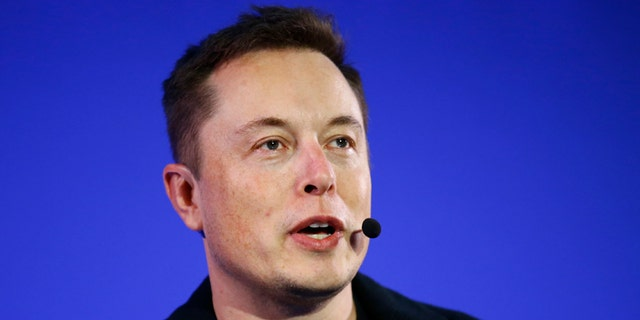 FILE - In this Wednesday, Dec. 2, 2015, file photo, Tesla Motors Inc. CEO Elon Musk delivers a conference at the Paris Pantheon Sorbonne University as part of the United Nations Climate Change Conference in Paris. Electric car maker Tesla Motors is offering to buy solar panel maker SolarCity for up to $2.8 billion in an attempt to create a one-stop shop for cleaner energy as consumers become more concerned about fossil fuels hurting the environment. The all-stock announced Tuesday, June 21, 2016, values SolarCity Corp. at $26.50 to $28.50 per share, depending on a review of the company's books. (AP Photo/Francois Mori, File)