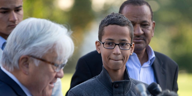 Ahmed Mohamed, second from right, listens as Rep. Mike Honda, D-Calif., left, speaks during a news conference on Capitol Hill in Washington. (AP Photo/Carolyn Kaster)