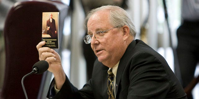 """Sept. 24, 2010: Texas State Board of Education member David Bradley challenges Brian Spears of Americans United for the Separation of Church and State to find the phrase """"separation of church and state"""" in the U.S. Constitution during a meeting of the board to discuss Islam and Christianity in textbooks in Austin, Texas."""