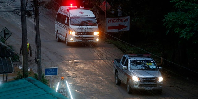 One of two ambulances leave the cave in northern Thailand hours after operation began to rescue the trapped youth soccer players and their coach.