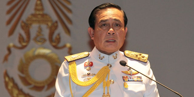 FILE - In this Monday, May 26, 2014 file photo, Gen. Prayuth Chan-ocha speaks at the start of a press conference. (AP Photo/Sakchai Lalit, File)