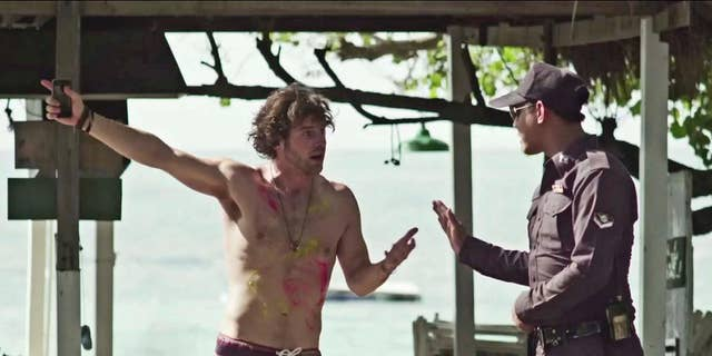 """In this undated image made from a video produced by the Tourism Authority of Thailand, a fictional British tourist talks to a policeman after losing his bag on a beach in Thailand. A video called """"I Hate Thailand,"""" which drew more than 1 million views within days of being posted, turned out to be produced by Thailand's tourism authority, using a strategy of reverse psychology to attract tourists after the country's image was battered by a military coup in May and the brutal murders of two British tourists on an idyllic beach in September. (AP Photo/Tourism Authority of Thailand)"""