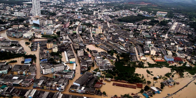 An aerial view shows the flooded Hat Yai district of Songkhla province, south of Bangkok, on Tuesday Nov 2, 2010. A tropical depression that dumped two days of constant rain on southern Thailand has caused flooding that forced rail service to shut down and thousands of residents to flee.