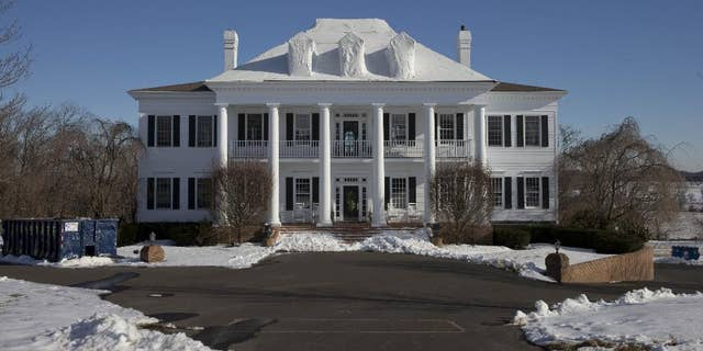 """FILE - In this Wednesday, Feb. 11, 2015 photo shows the mansion called """"Clairemont,"""" in New Hope, Pa.   The family whose mansion burned three times in five years heads to court for a hearing to determine if they'll face trial in a $20 million insurance fraud case. The state attorney general's office has accused political fundraiser and hostess Claire Risoldi and her family of living large on trumped-up insurance claims. A grand jury report says the home in suburban Philadelphia has had three suspicious fires in five years. (AP Photo/Matt Rourke)"""