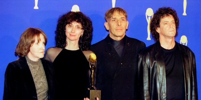 """The rock group """"The Velvet Underground"""" (R-L) Lou Reed, John Cale, Martha Morrison (wife of Sterling Morrison) and Maureen Tucker, pose for photographers shortly after being inducted in the Rock & Roll Hall of Fame at the eleventh annual Rock & Roll Hale of Fame induction dinner at the Waldorf Astoria Hotel, in New York, January 17 - RTXGAJ2"""