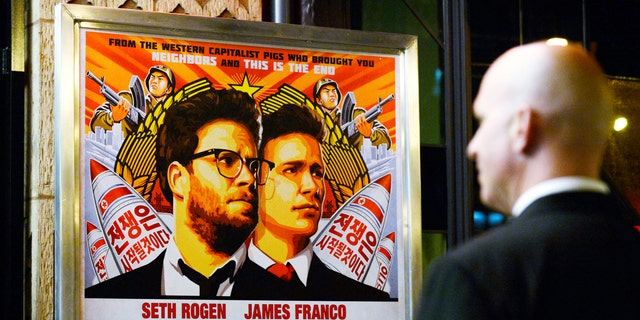 """A security guard stands at the entrance of United Artists theater during the premiere of the film """"The Interview"""" in Los Angeles, Dec.11."""