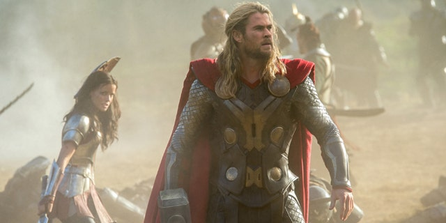 """This publicity photo released by Walt Disney Studios and Marvel shows Jaimie Alexander, left, and Chris Hemsworth in a scene from """"Thor: The Dark World."""""""