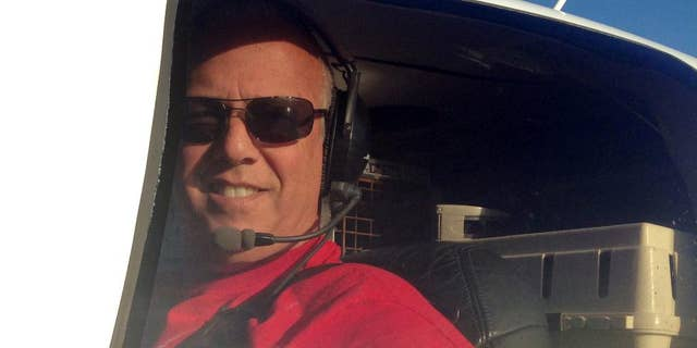 In this Dec. 10, 2014 photo, Jeff Bennett arrives with his 3,000th rescue animal to safety in Tampa, Fla. Bennett flew to the Florida Panhandle and picked up a French bulldog named Reggie, along with several other animals, from shelters and foster homes in Alabama.  Bennett has been flying animals from overcrowded shelters to foster homes and vacant shelters for six years. (AP Photo/ Tamara Lush)