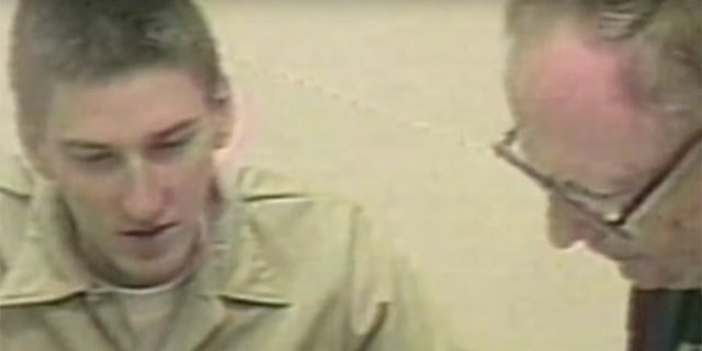 Timothy McVeigh (left) speaking with one of his defense attorneys.