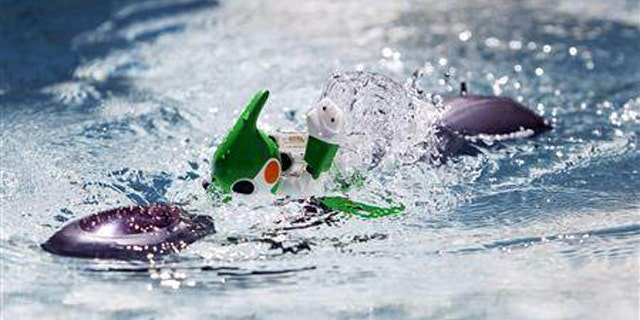 """Sept. 15, 2011: Panasonic's """"Evolta"""" swim robot, powered by the company's Evolta rechargable batteries, is demonstrated at a pool during a news conference in Tokyo."""