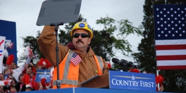 """Tito """"the builder"""" Muñoz speaks at a McCain rally."""