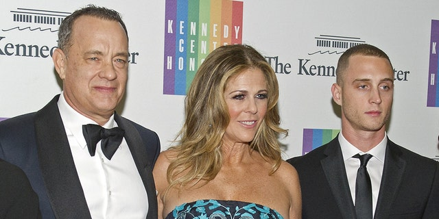"Chet Hanks, right, was sued in 2016 after he was accused of being ""under the influence of drugs and/or alcohol"" during an alleged auto collision. His parents Tom Hanks, left, and Rita Wilson, center, were also named in the suit."