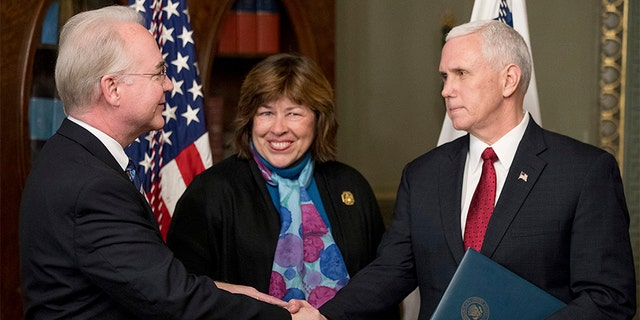 Vice President Mike Pence shakes hands with Health and Human Services Secretary Tom Price, accompanied by his wife Betty, after a swearing-in ceremony, Friday, Feb. 10, 2017, in the in the Eisenhower Executive Office Building on the White House complex in Washington. (AP Photo/Andrew Harnik)
