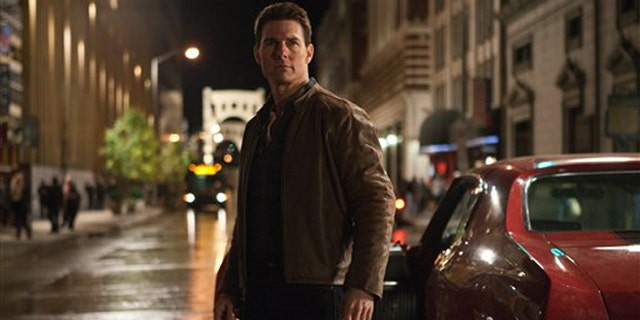 """In this publicity photo provided by Paramount Pictures, actor Tom Cruise, center, is Jack Reacher in film, """"Jack Reacher,"""" from Paramount Pictures and Skydance Productions."""