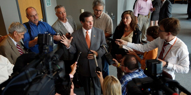 FILE: Former U.S. House Majority Leader Tom DeLay speaks to the media during a break at his pre-trial hearing on Aug. 24.