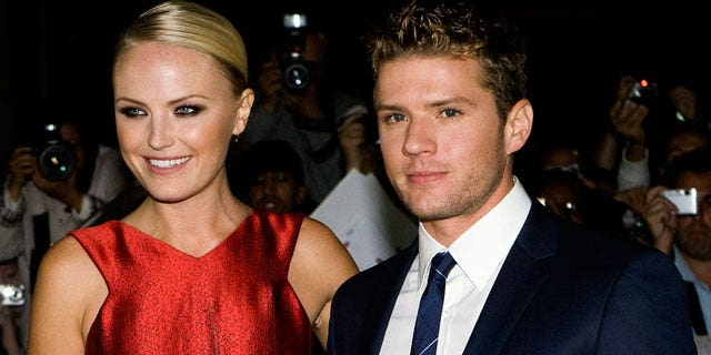 Sept. 15: Ryan Phillippe, right, and Malin Akerman pose for a photograph on the red carpet for the screening of The Bang Bang Club during the 2010 Toronto International Film Festival in Toronto.