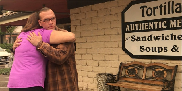 """James Welch, seen here embracing his manager at their restaurant, described his grandmother's death as """"such a tragedy."""""""
