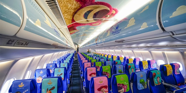 Inside, travelers are met with brightly colored seats (featuring their favorite characters on the headrest), themed in-flight headphones, check in machines, and food and drink menus.