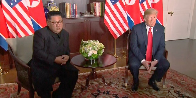 In this image made from video provided by Host Broadcaster Mediacorp Pte Ltd,, U.S. President Donald Trump and North Korean leader Kim Jong Un sit together for their meeting at Capella Hotel in Singapore, Tuesday, June 12, 2018. (Host Broadcaster Mediacorp Pte Ltd via AP)