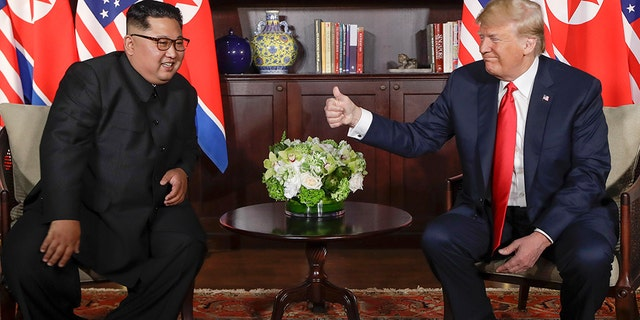 Chairman of the DPRK Kim Jong Un, left, meets with President Trump, right, at the Capella Hotel on Sentosa Island in Singapore on June 12, 2018.