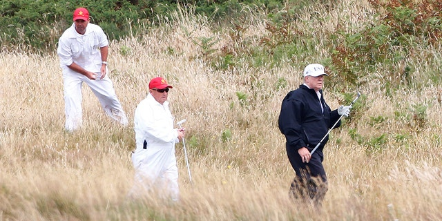 President Trump hits the golf course while on his visit to Scotland.