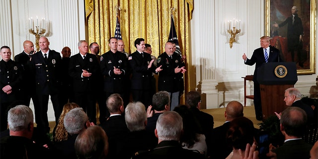 President Donald Trump applauds for Medal of Valor recipients during a Public Safety Medal of Valor Awards Ceremony at the White House in Washington, U.S., February 20, 2018.