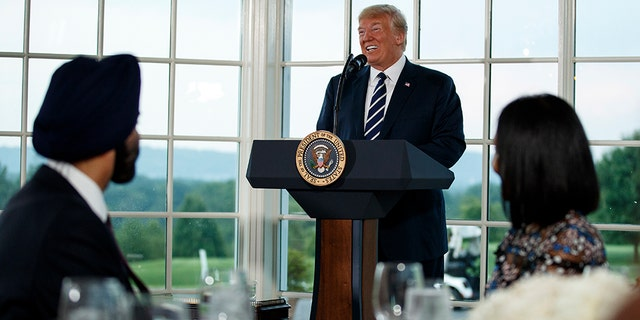 President Donald Trump speaks at a dinner meeting with business leaders, Tuesday, Aug. 7, 2018, at Trump National Golf Club in Bedminster, N.J. (AP Photo/Carolyn Kaster)